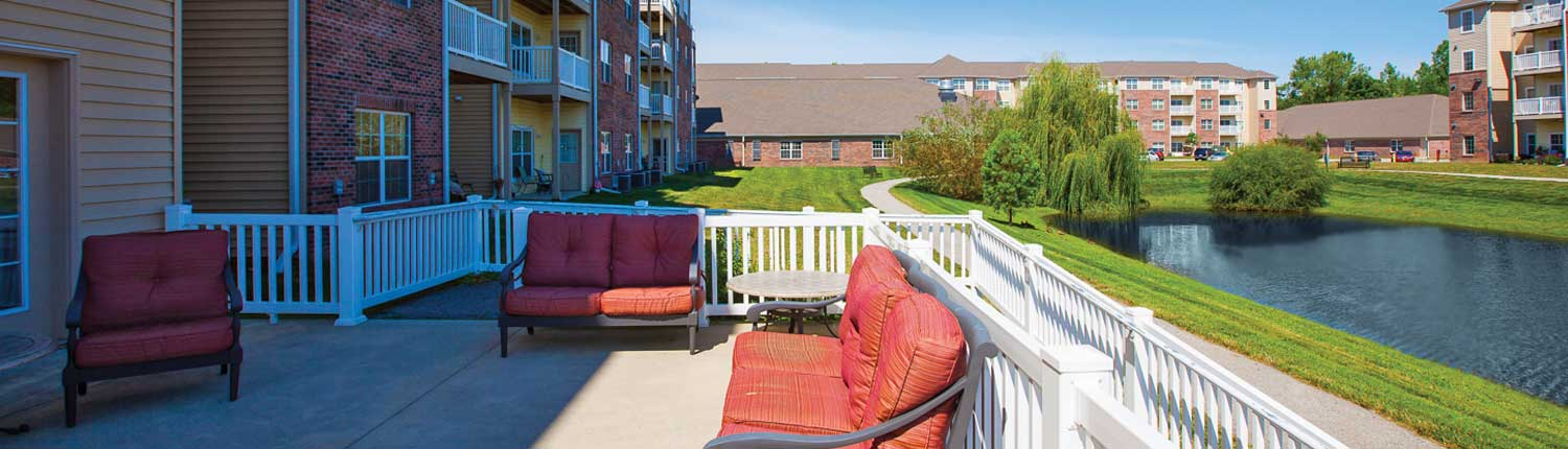 Brookhaven Apartment Community Outside Deck with Pond